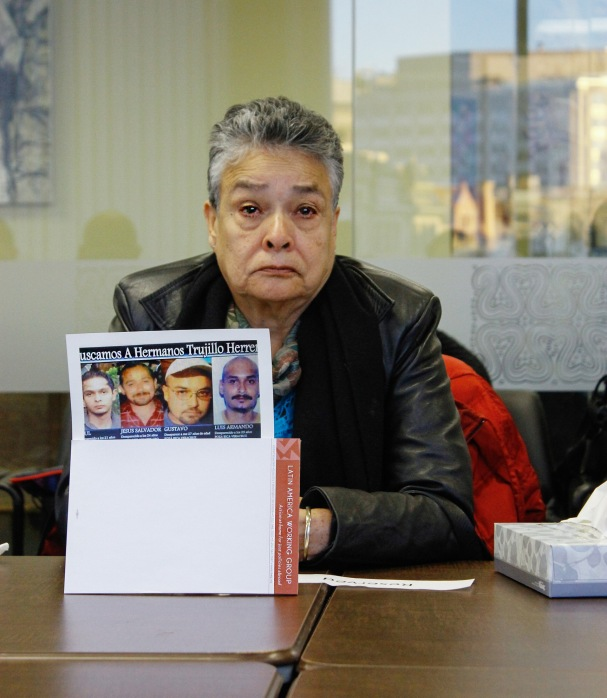 "Doña Mari displays photos of her four disappeared sons without whom she says she is ""dead in life."""