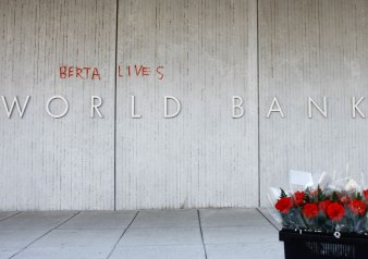 "The first to gather for an April 5, 2016 vigil outside of the World Bank building were surprised to find that someone had scrawled ""Berta Lives"" by the front entrance with a blood red paint marker."