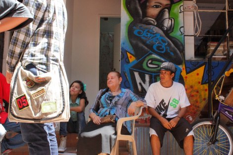 """Margoth Yepes, known as """"La Abuela Rapera,"""" watches the rappers freestyling."""
