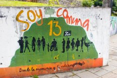 "A mural painted near the San Javier Library reads: ""I am Comuna 13, where memory and life are present."""