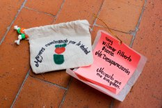 "Women Wallking for Truth member Luz Elena Galeano Laverde hand made pouches containing ""notes from the disappeared"" for distribution at an event commemorating Operation Orion. This note reads: ""I am Wilmar Alberto Osorio. They disappeared me. I need you to find me."""