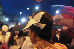 One marcher secured a white peace dove to his hat during an October 7 march for peace in Medellín, Colombia.
