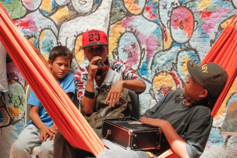 "Young rappers take turns freestyling in the open air patio of ""La Casa Morada,"" an activist meeting place in Medellín's Comuna 13 neighborhood."