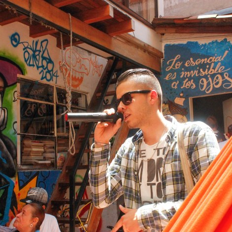 "A young rapper freestyles in the open air patio of ""La Casa Morada,"" an activist meeting place in Medellín's Comuna 13 neighborhood."
